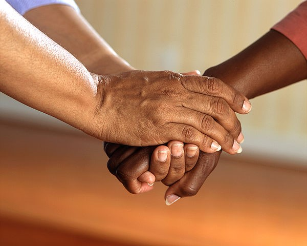 hands clasped in support