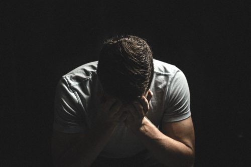 man with headache medical issues